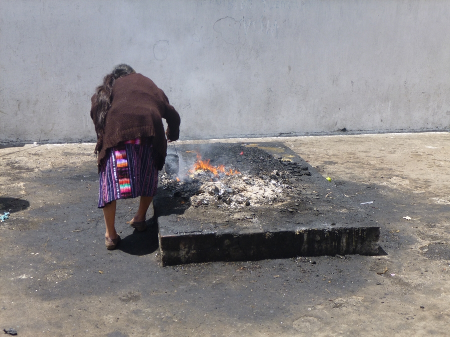 A Lady Performing Her Mayan Ceremony on An Altar Outside A Chapel, El Calvario
