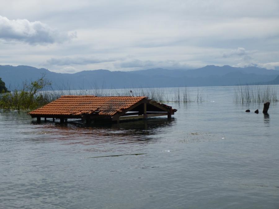 Submerged Houses In San Pedro Due To Rising Lake Water