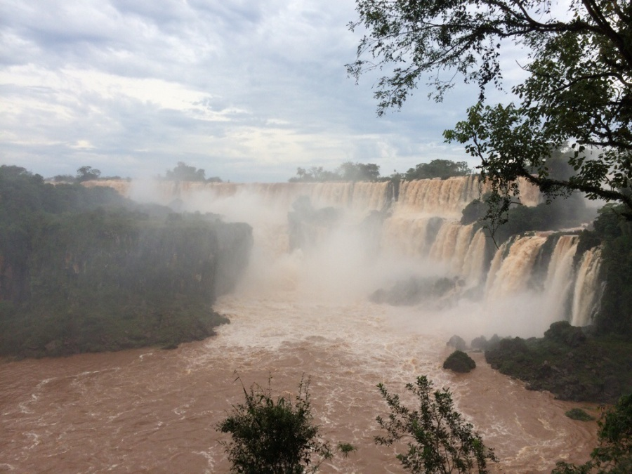 Iguassu Falls - Argentina The high level of water is caused by heavy rain. San Martin Island has to be closed due to the high water level. And the water color is especially red due to the sediments on riverbanks that got washed off.