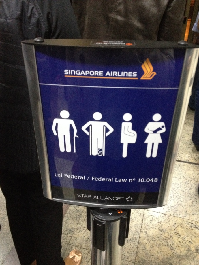 A Typical Sign Showing Groups With Priorities To Board or Queue (It's a LAW!)