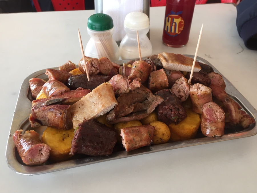 Bandeja of longaniza (sausages), murcilla (blood sausages), grilled beef, criolla potatoes, grilled port, and patacones in La Fogata, Sutamarchan