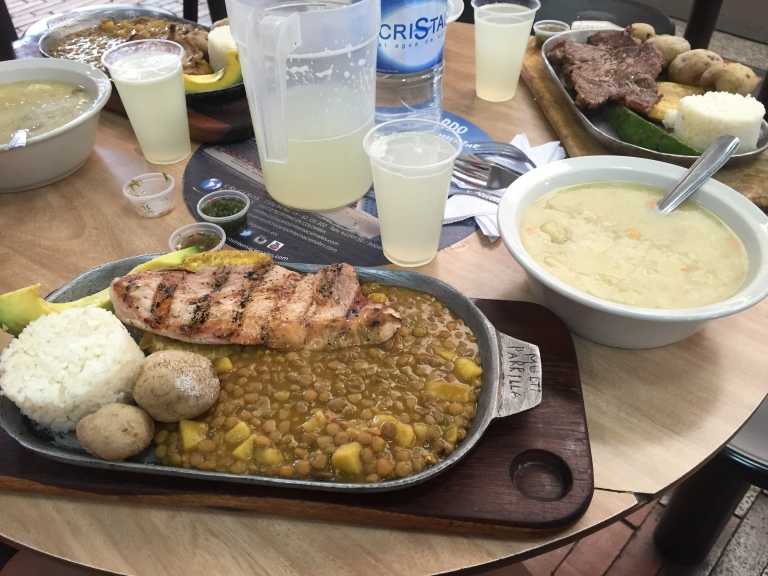 Corriantazo meal (grilled chicken, potatoes, rice, lentils, banana, rice soup, and lemonade) for a mere USD3.50