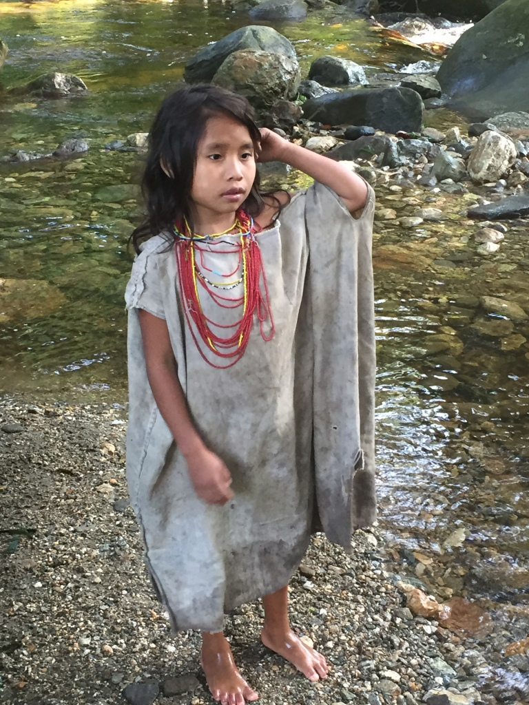 Kogui's Girl Posing With Her New Bracelet Given By A Team Mate. The Girls Wear Necklaces. The Boys Carry Sling Bags.