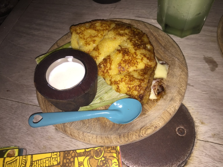 Arepa de Chocolo (Sweet Corn Arepa With Cheese) Served with Sour Cream at Andres Carne de Res