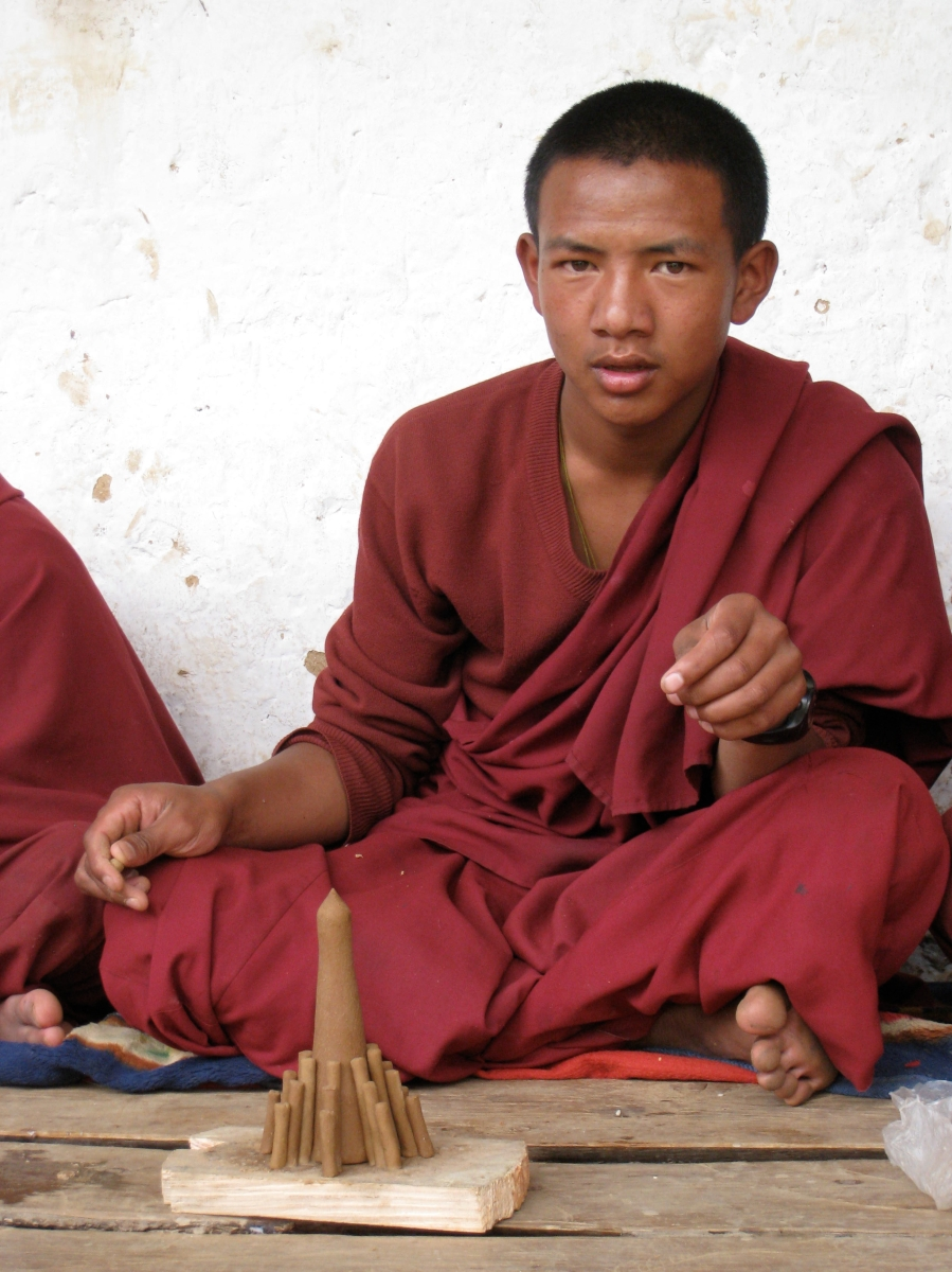 A Young Monk Completing His Daily Task - Making Butter Candle For Prayers