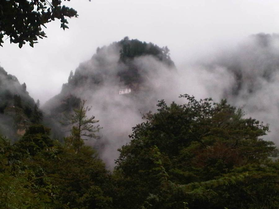 Mountain Where Paro Taktsang Monastery is Located (You Can See The Monastery Behind The Cloud) - Photo Taken From The Start of The Trek