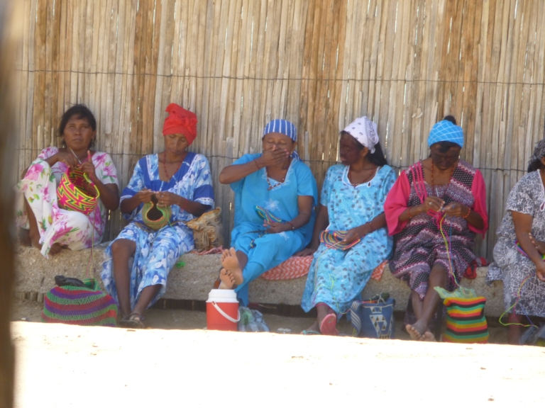 Wayuu Women Working On Their Crafts Under The Shade. Their Faces Were Painted Black To Reduce The Effect of The Sun