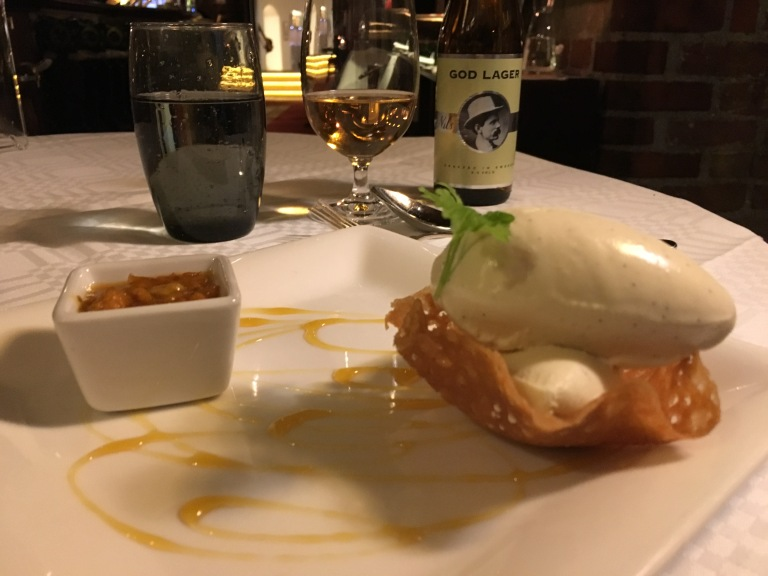 Freshly made vanilla ice cream with compote of cloudberries, accompanied by Swedish beer by Nils Oscar at Arstiderna i Kockska Huset in Malmö.