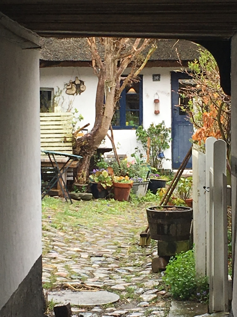 Charming courtyard of a traditional cottage in St. Jørgensberg fishing hamlet.