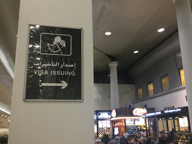 Visa issuing counters are now behind Starbucks